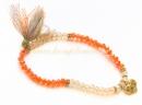 Браслет оранжево-золотого цвета, с кисточкой